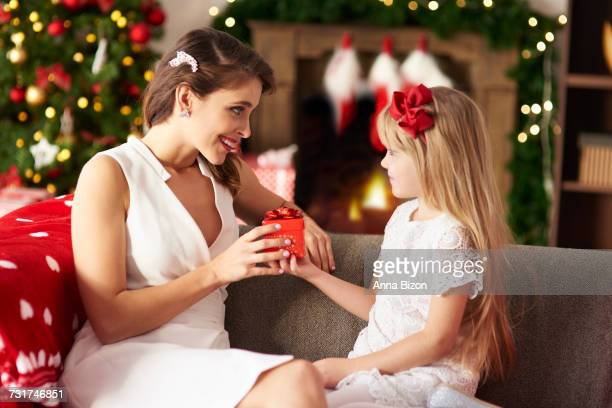 Blond girl giving another present to mummy. Debica, Poland