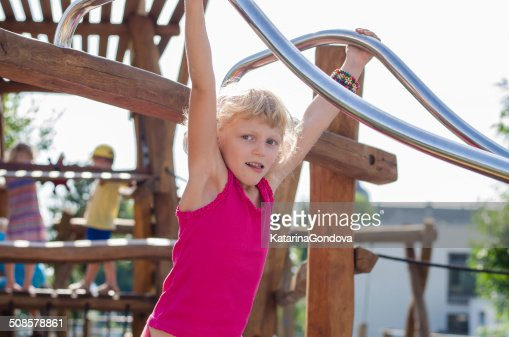 blond girl on playground : Stock Photo