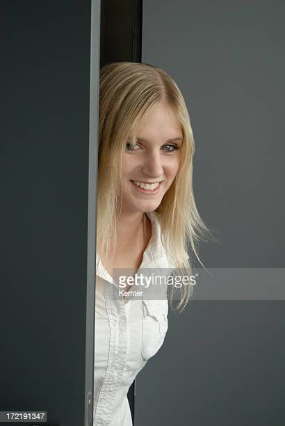blond girl smiling at the door