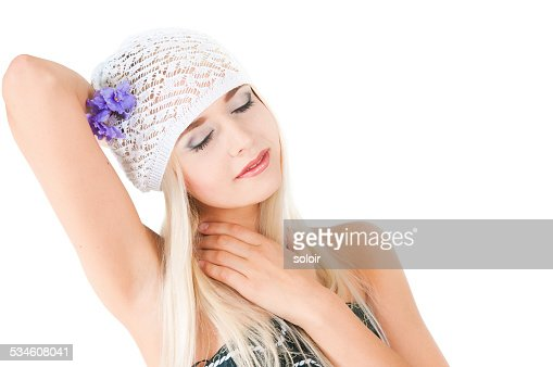 blond girl with a bouquet of violets : Stock Photo