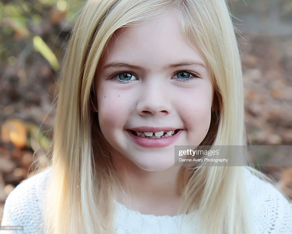 Blond hair blue eyes huge smile orange leaves : Stock Photo