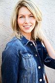 Portrait of blond woman in denim, smiling
