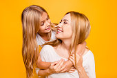 Blond joy enjoy holiday laughter joke two people concept. Close up portrait of charming cute sweet lovely adorable beautiful carefree playful with toothy smile mom mum mummy kid isolated on background