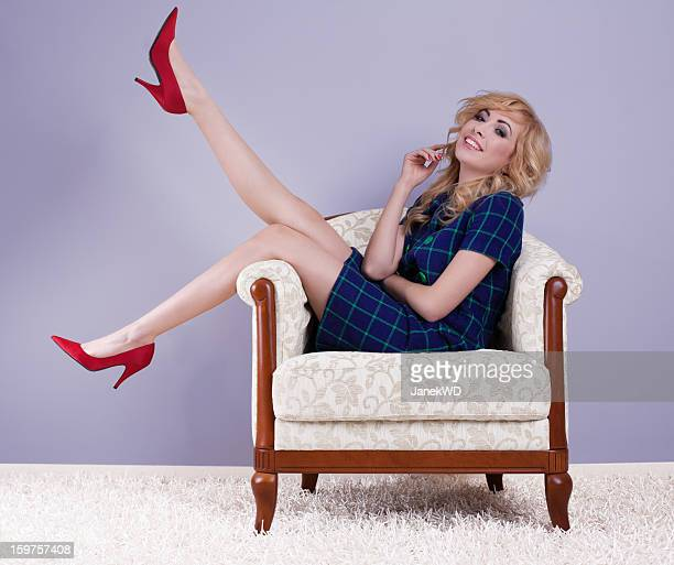Blond shoe lover on a armchair, blue