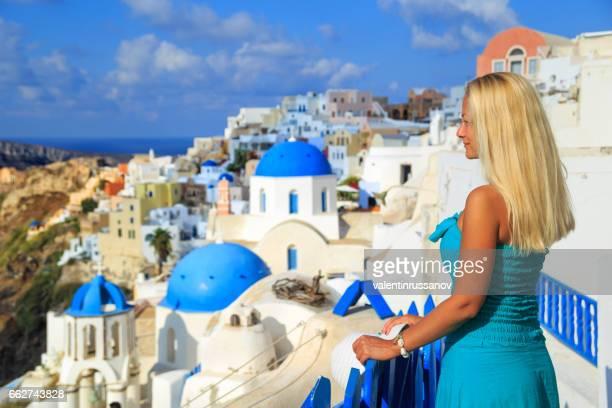 Blond woman enjoying the view of Santorini