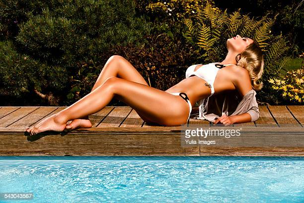 Blond Woman in White Bikini Posing at Pool