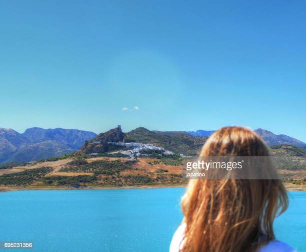 Blond woman looking at beautiful village of Zahara de la Sierra