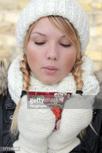 Blond woman outdoor, holding a cup of tea : Stock Photo
