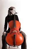 Blond woman playing cello (cellist)