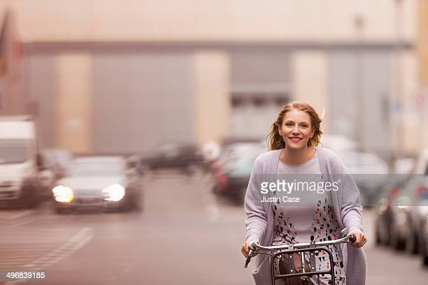 blond woman riding her bike in the city