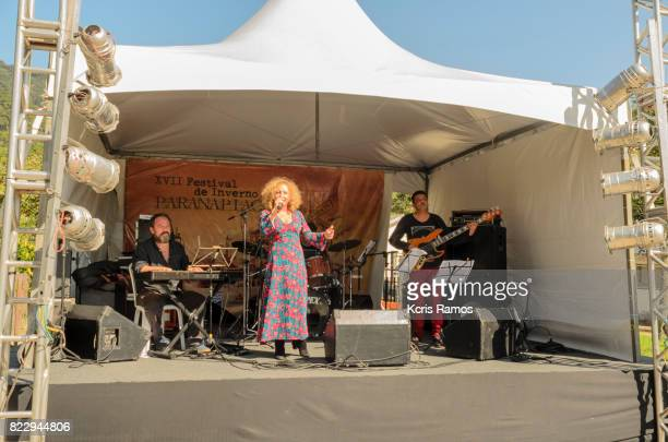 Blond woman singing on street stage in the village of paranapiacaba in brazil at winter festival