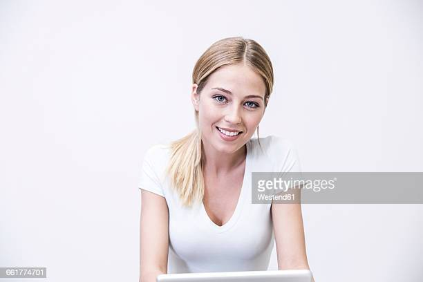 Blond woman using digital tablet