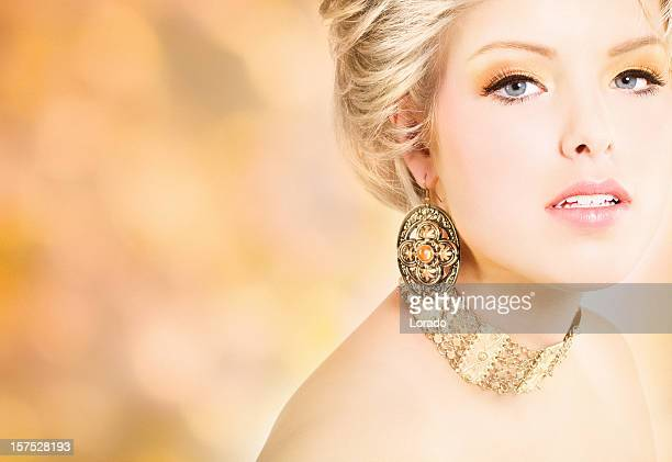 blond woman wearing jewelry