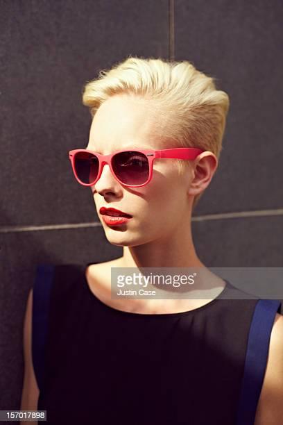 A blond woman wearing sunglasses