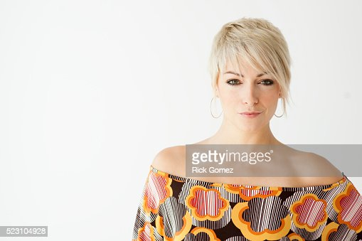 Blond woman with colorful blouse