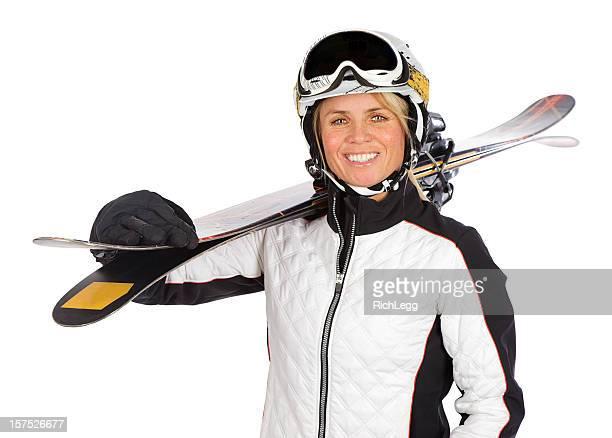 Femme blonde avec des pistes de ski
