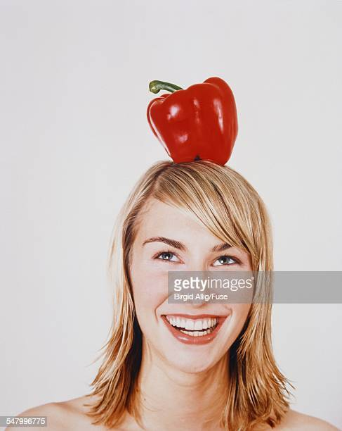 Blond Woman with Red Pepper on Head