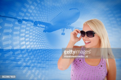 Composite image of blond woman with sunglasses : Stock Photo