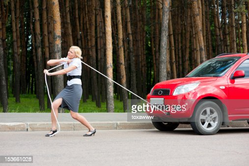 Blonde and broken car : Stock Photo