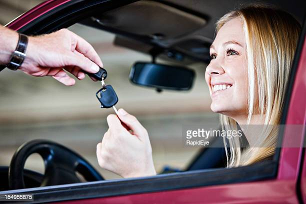 Blonde babe smiles as she receives keys to car