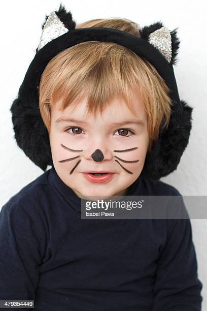 Blonde baby dressed up as a cat