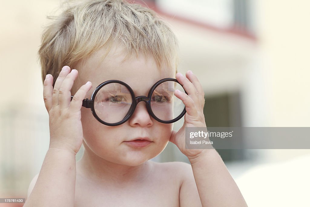 Blonde baby with glasses : Stock Photo
