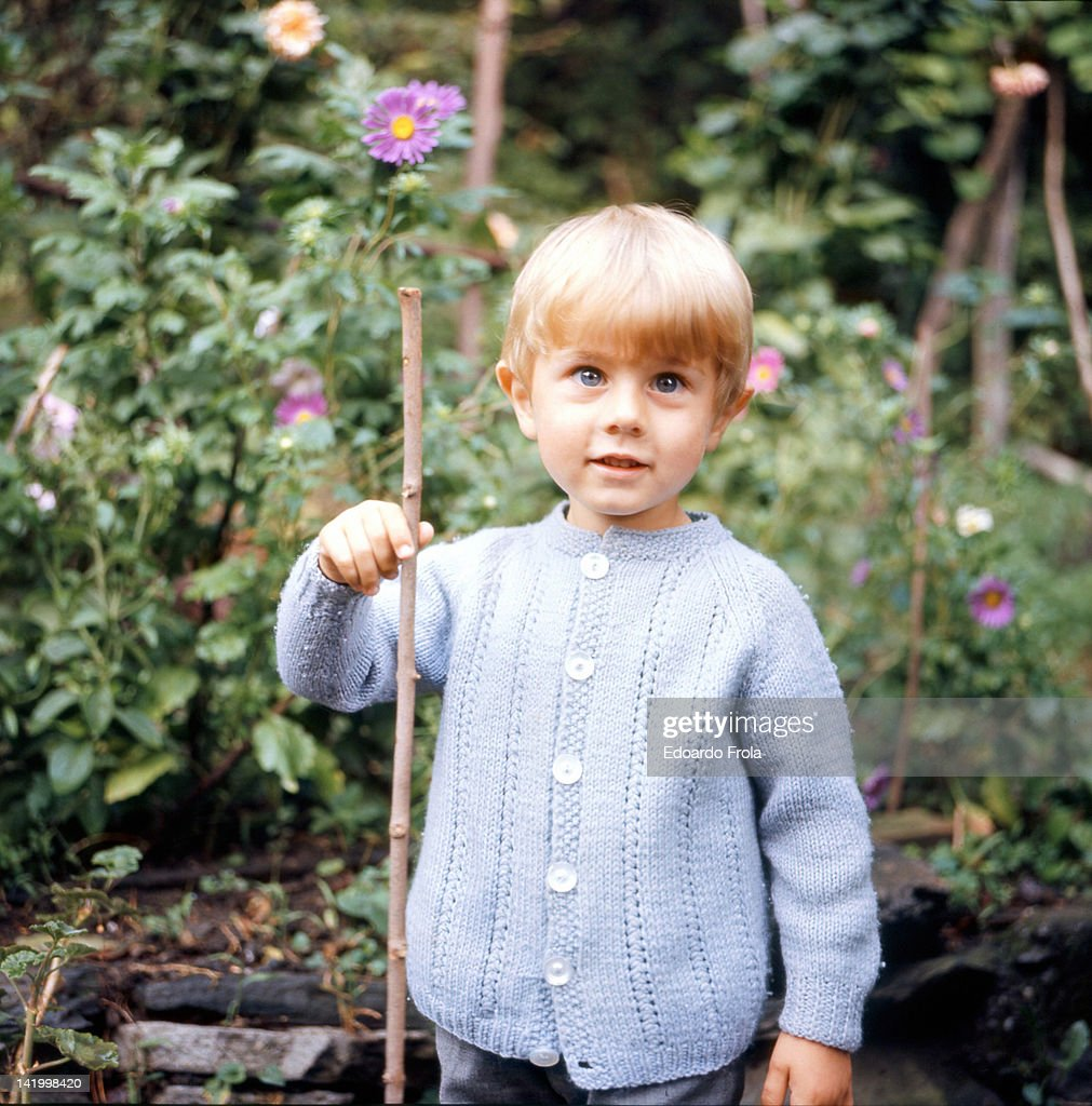 Blonde boy holding stick : Stock Photo