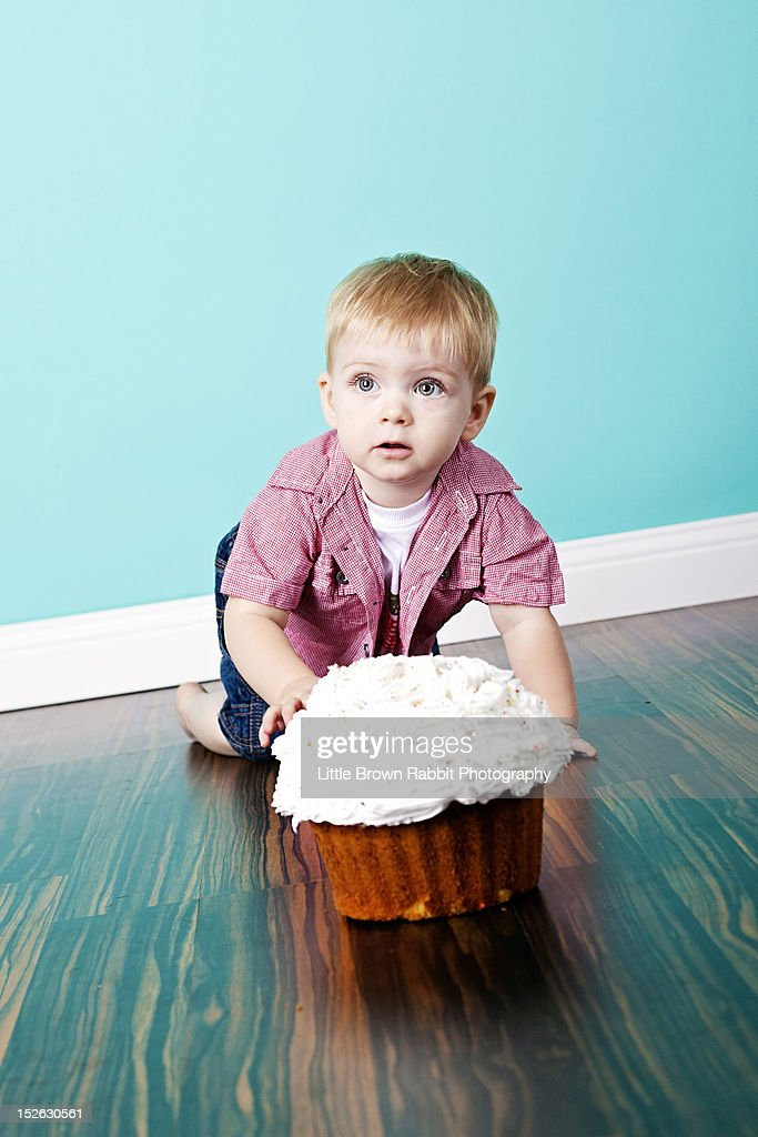 Blonde boy with cake : Stock Photo