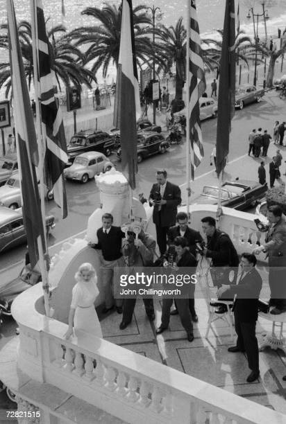 Blonde British actress Diana Dors surrounded by photographers at the Cannes Film Festival 13th May 1956 Original Publication Picture Post 8396 Diana...