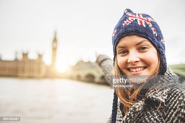 blonde british tourist in london smiling against the Big Ben