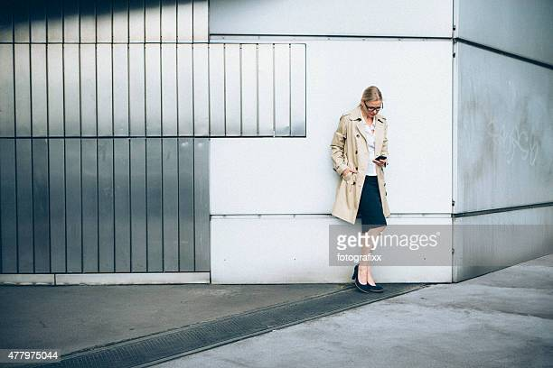 blonde Businesswoman Checking her E-Mails on smart phone