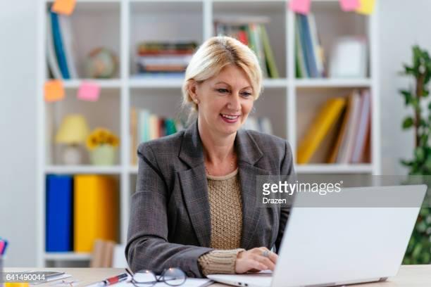 Blonde businesswoman working in office