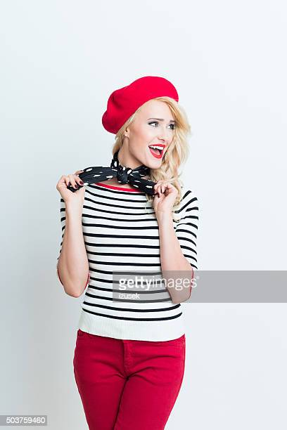 Blonde french woman wearing red beret