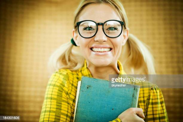 Blonde funny looking woman holding her notebook.