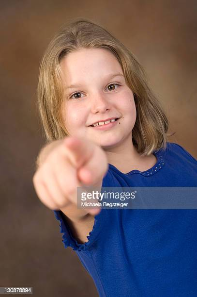 Blonde girl, 8 years old, pointing with forefinger