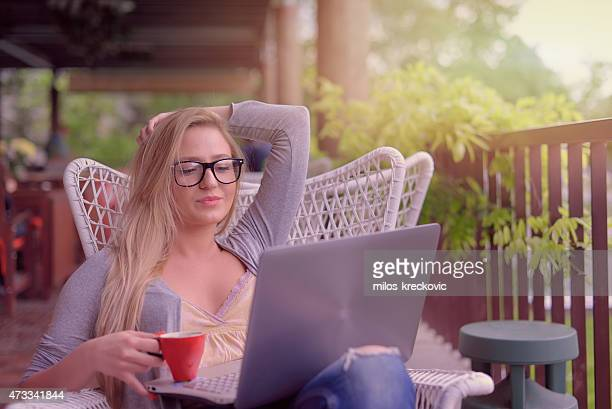 Blonde girl in the coffee shop on the laptop