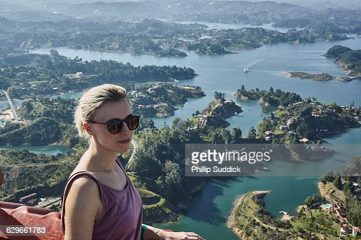 blonde girl smiling looking out from a high vista