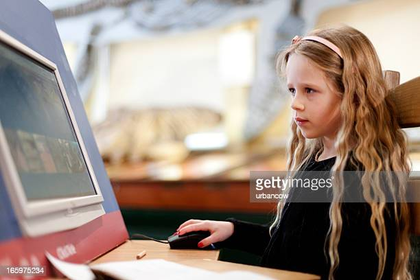 Blonde girl using an interactive display