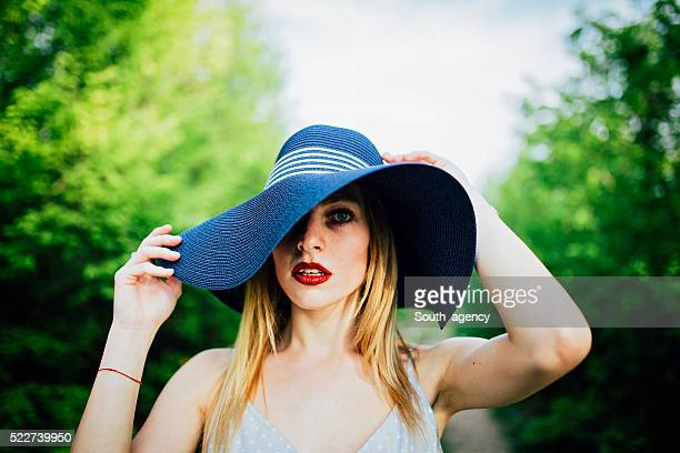 Blonde girl with hat
