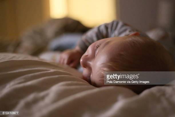Blonde hair baby sleeping at night