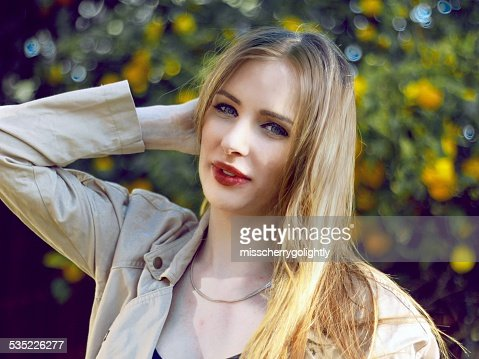 Blonde Hair Pale Skin And Red Lips Stock Photo Thinkstock