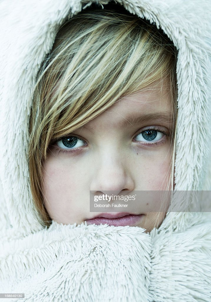 Blonde haired girl in white fur coat : Stock Photo
