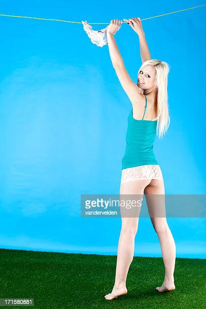 Blonde Hanging Panties On A Washing Line