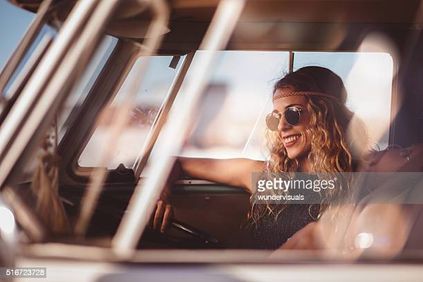 Blonde Hipster Girl Sitting in Interior of Retro Van
