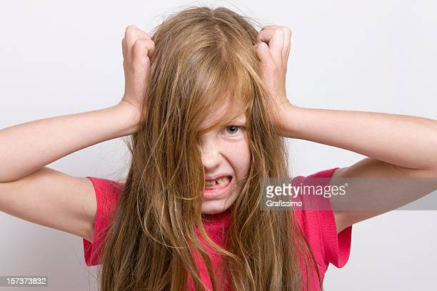 Blonde little girl tearing her hair out