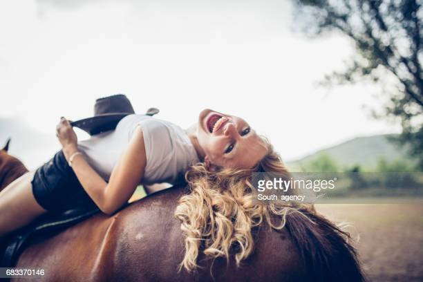 Blonde relaxing on a horse