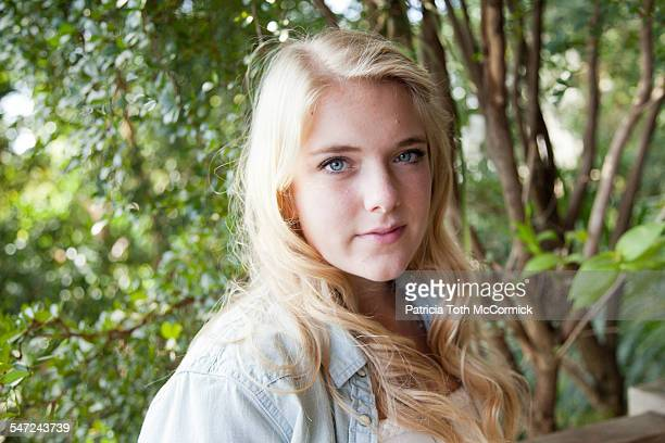 Blonde teen girl in garden