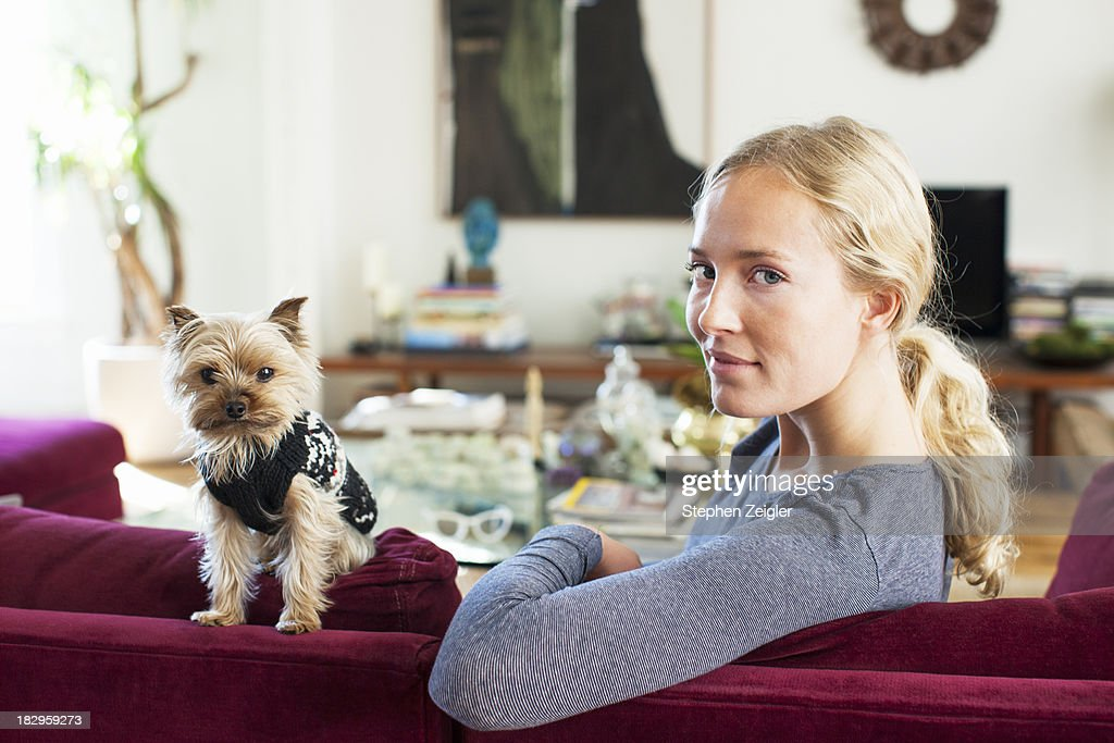 Blonde woman and small dog : Stock Photo