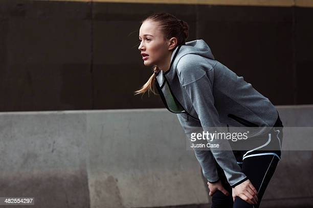 blonde woman catching her breath after running