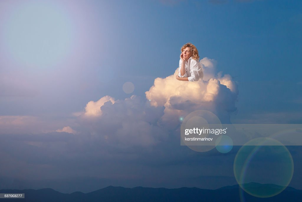 Blonde woman dreaming on cloud
